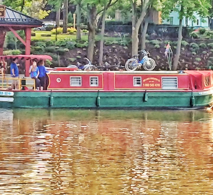 the long boats are the renters on the canal... expensive summer vacation. they come from the east, usually