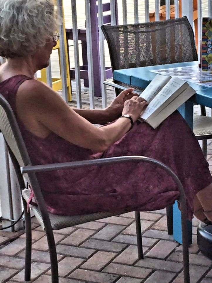 at the tiki br , she was sipping wine and reading a book, and smoking. no food for Her